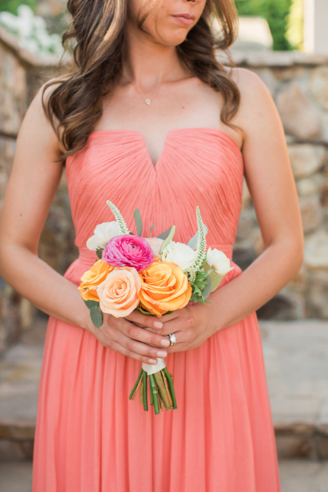 peach bridesmaids dress and bouquet