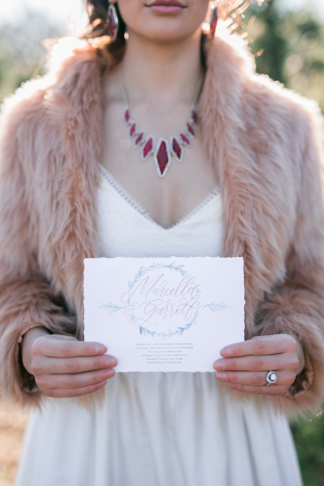 wedding invitation and warm fur coat