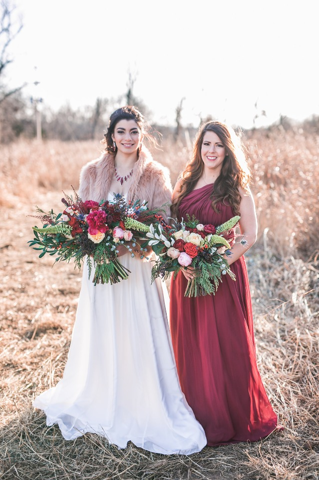 wintery bridal party in deep maroon and fur