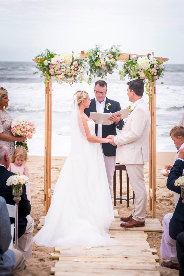Chic wedding arbor with flowers