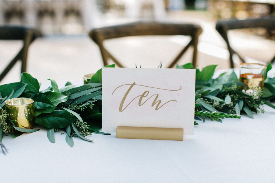 soft gold calligraphy wedding table number