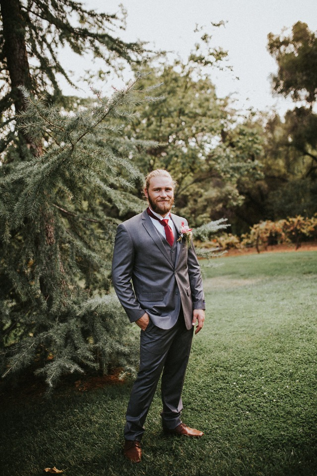 groom in grey and red