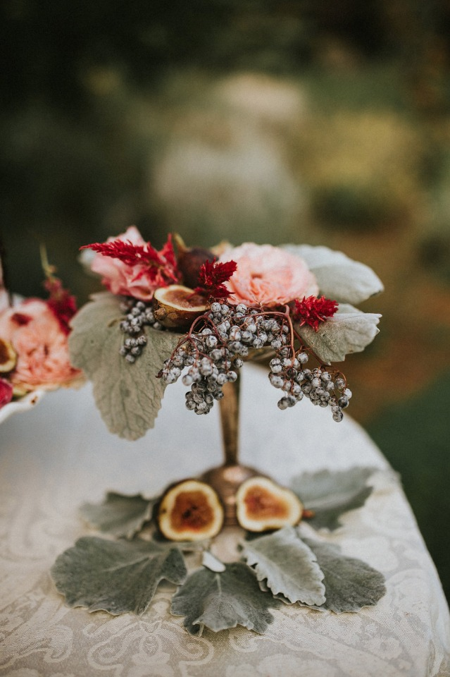 cake table decor with flowers and figs
