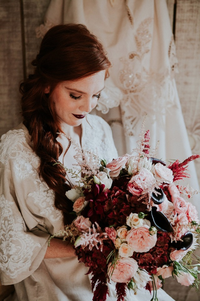 bride and her red and pink bouquet