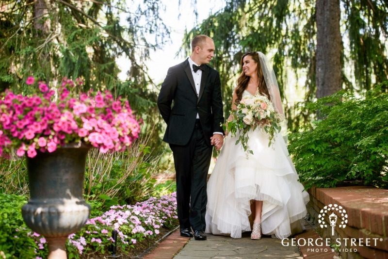 Strolling through the gardens at FEAST at Round Hill, Hudson Valley New York wedding venue. Photo by George Street Photography.