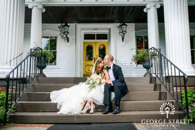 Enjoying a moment alone in front of Round Hill, Hudson Valley NY wedding venue. Photo by George Street Photography.