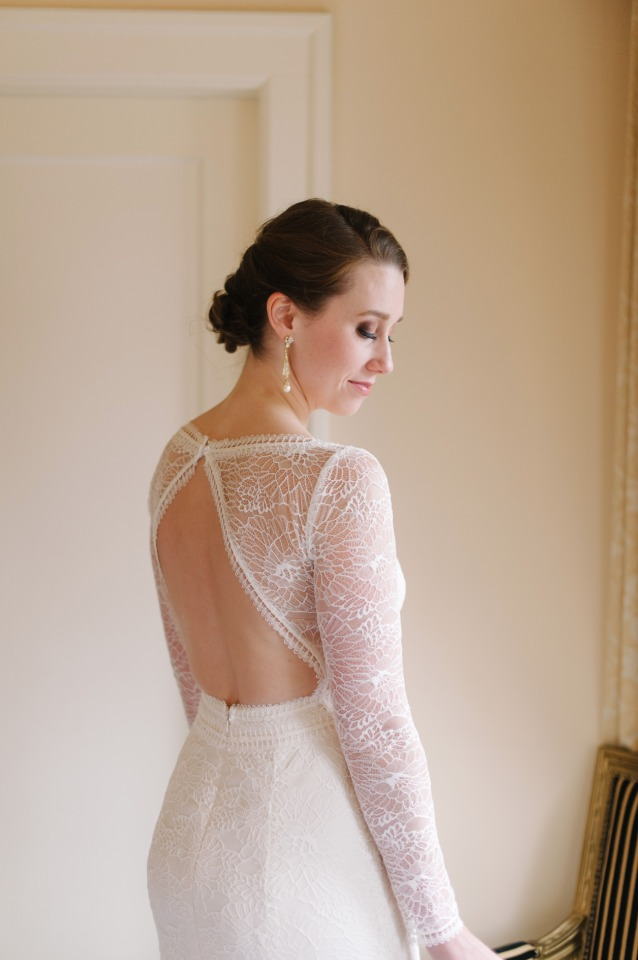 lacy long sleeved and back showcasing wedding dress