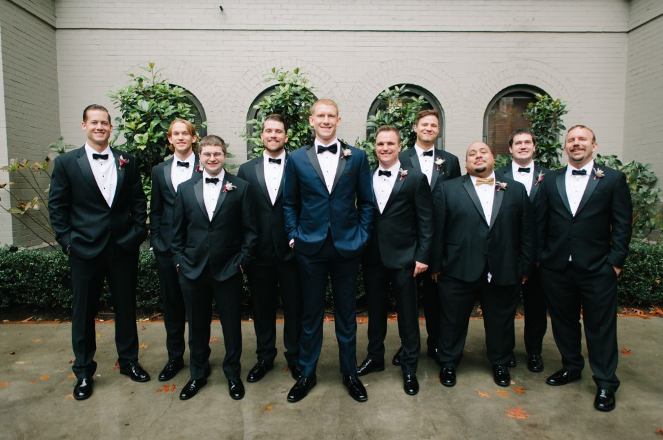 groom in navy and groomsmen in classic tuxedos