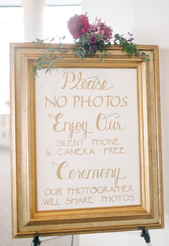 gold framed wedding ceremony sign