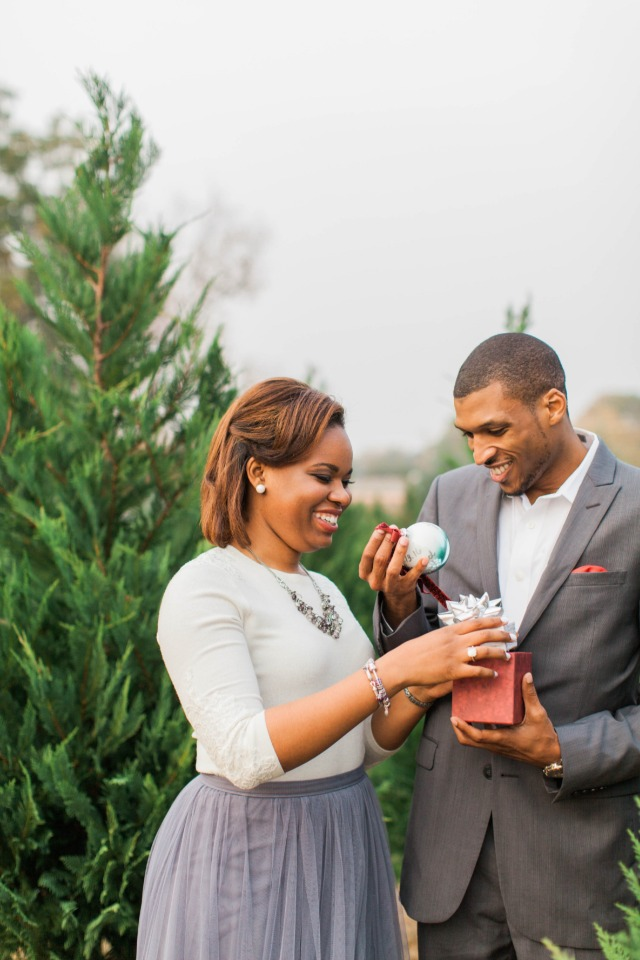 Surprise engagement at a Christmas tree farm