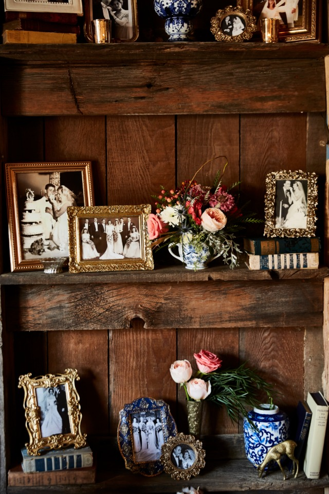 family photographs on a rustic shelves