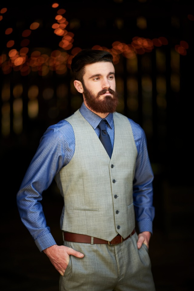 groom in grey vest and pants with a blue shirt and tie