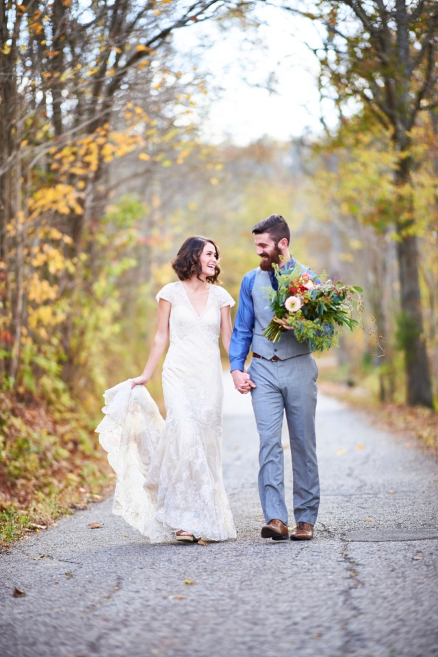 wedding couple taking a walk in the fall