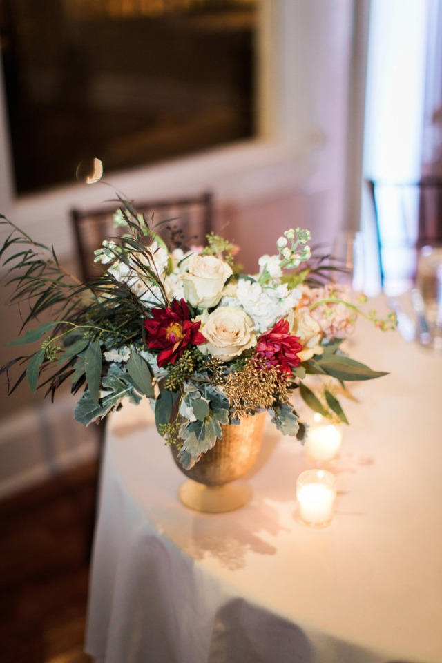 Floral centerpiece in a gold vase