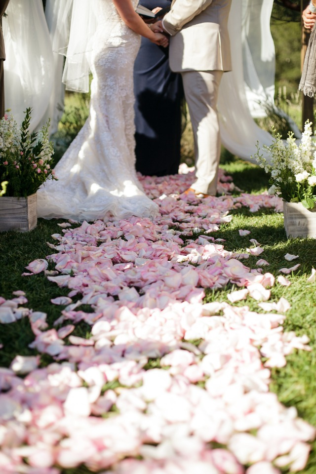 pink flower petal covered wedding aisle