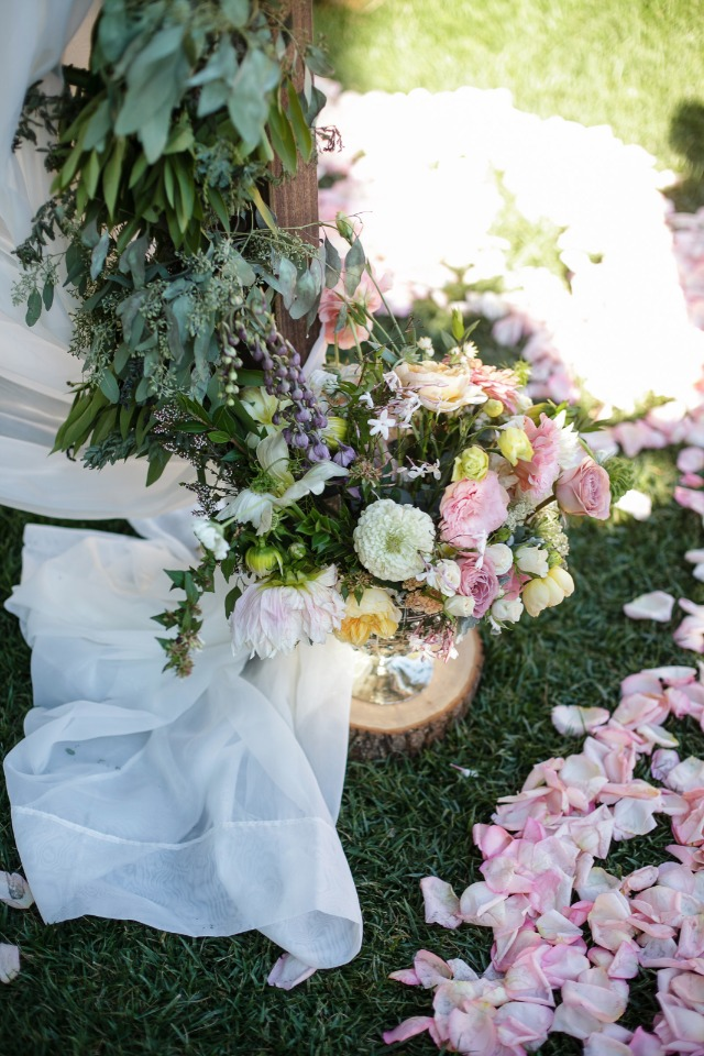 fresh flowers everywhere at this wedding ceremony