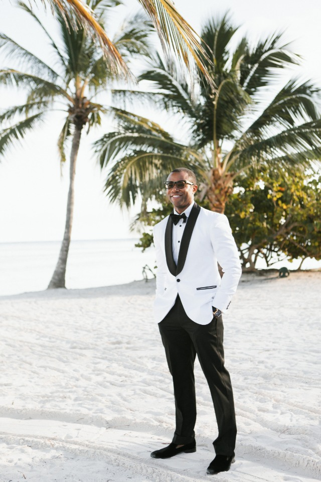 groom in white and black tuxedo