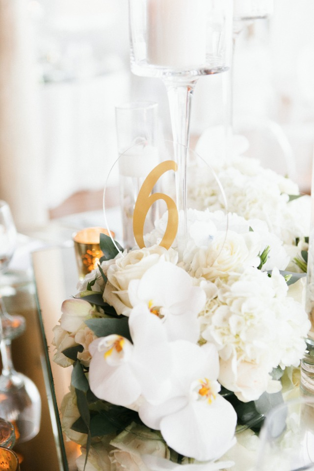gold and clear table number