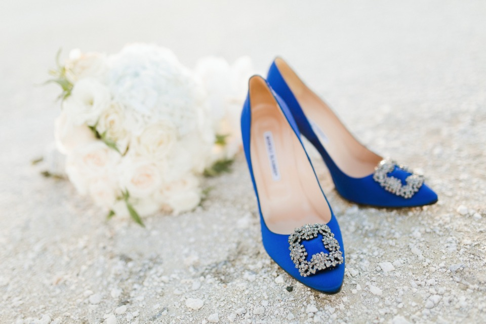 white bouquet and blue wedding shoes