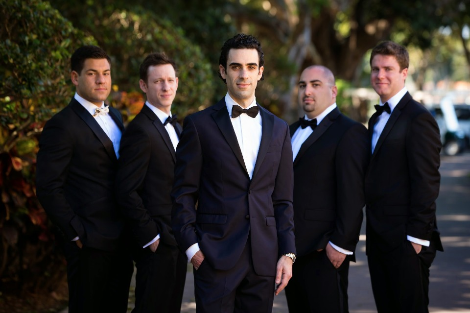 Classic black bow tie look for the groom and his men