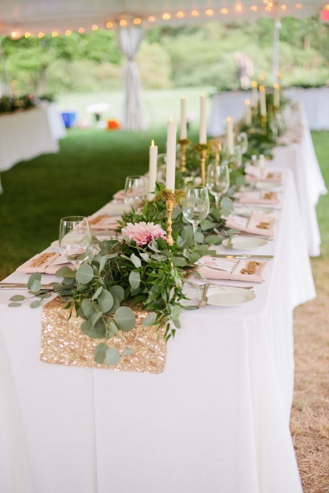 Garland centerpiece with a sparkly table runner and candles
