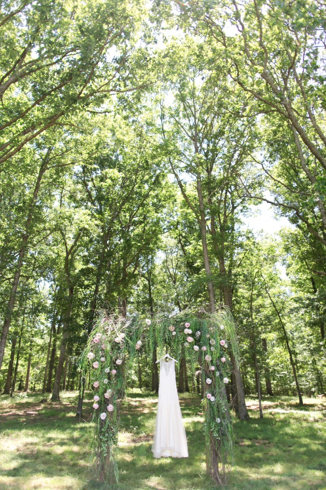 wedding dress and wedding arch