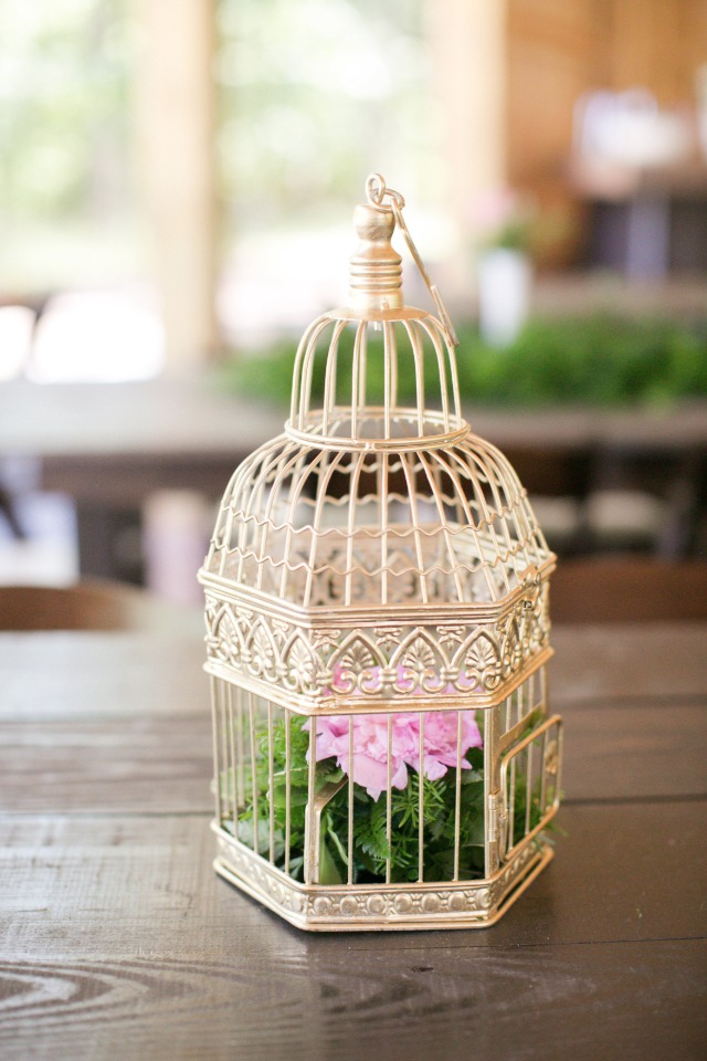 gold bird cage flower arrangement