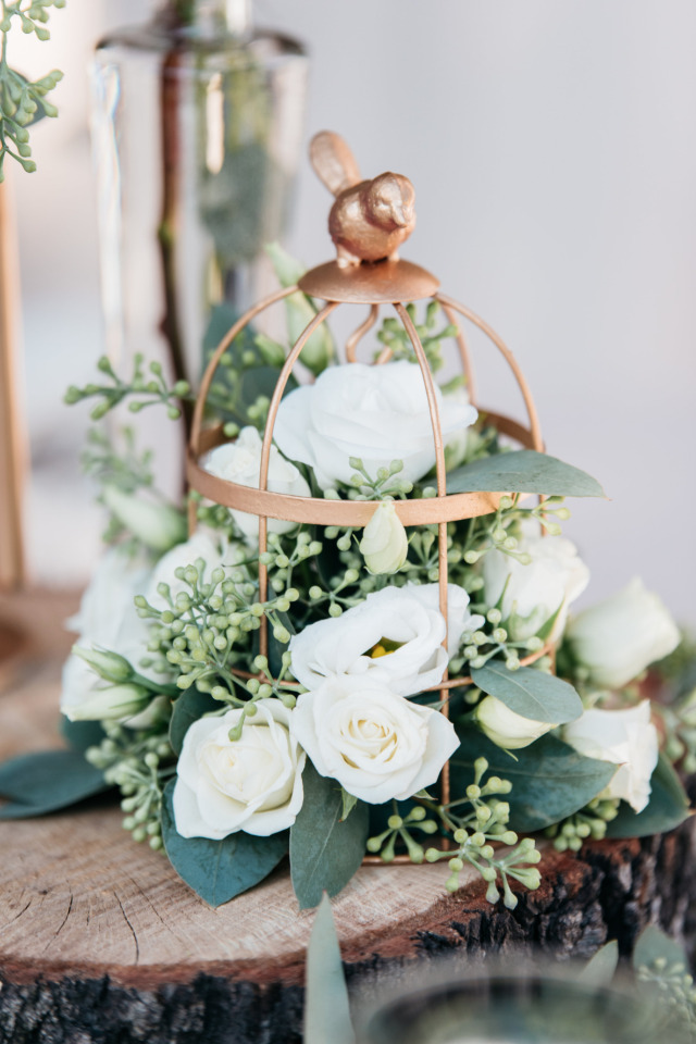 gold bird cage with flowers wedding decor