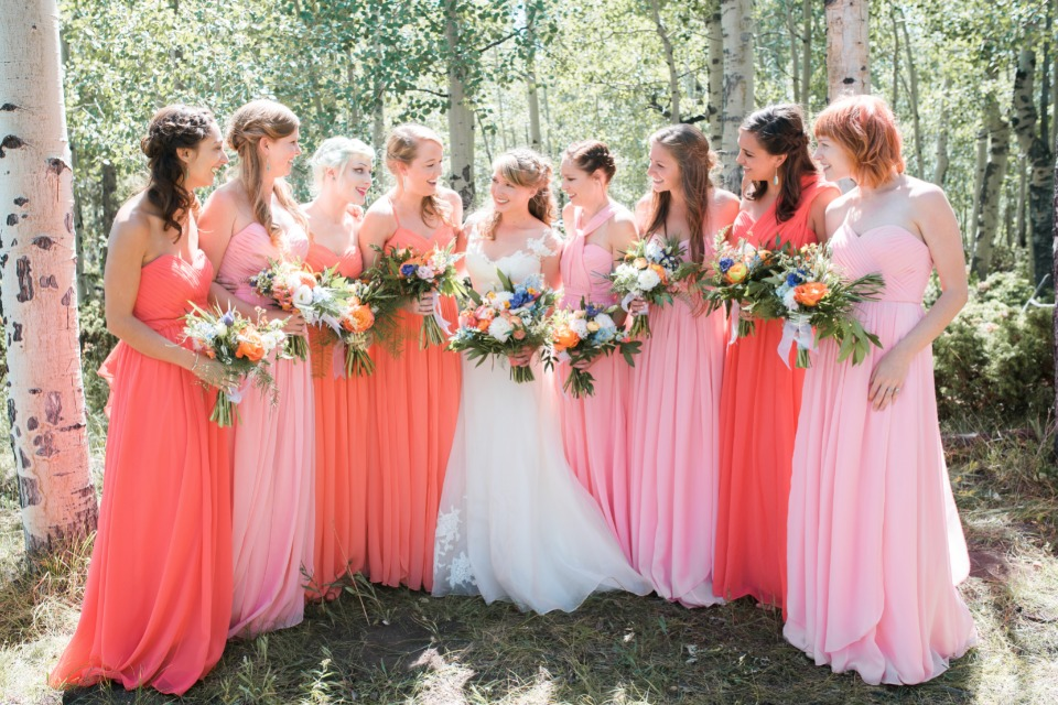 assorted coral bridesmaid dresses