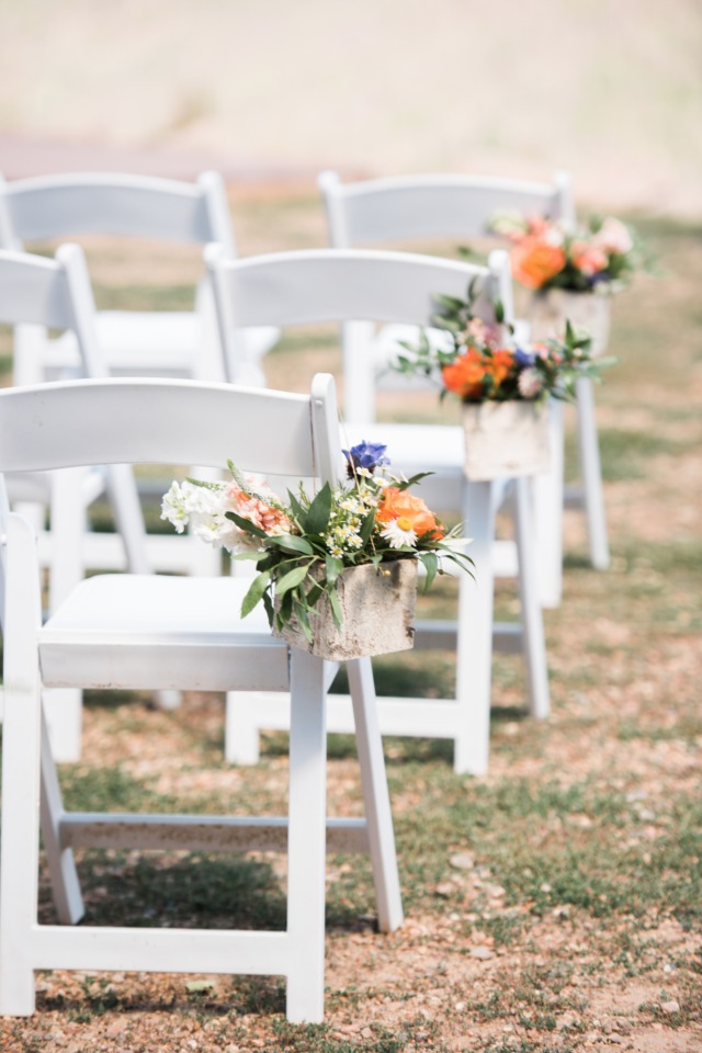 flower accented wedding aisle
