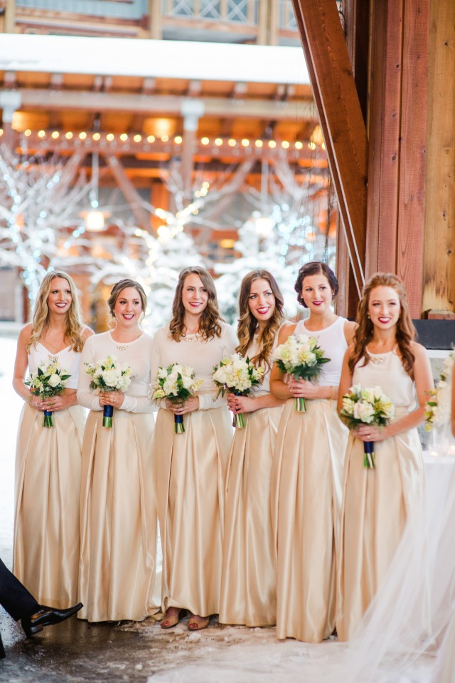 Bridesmaids in champagne colored skirts