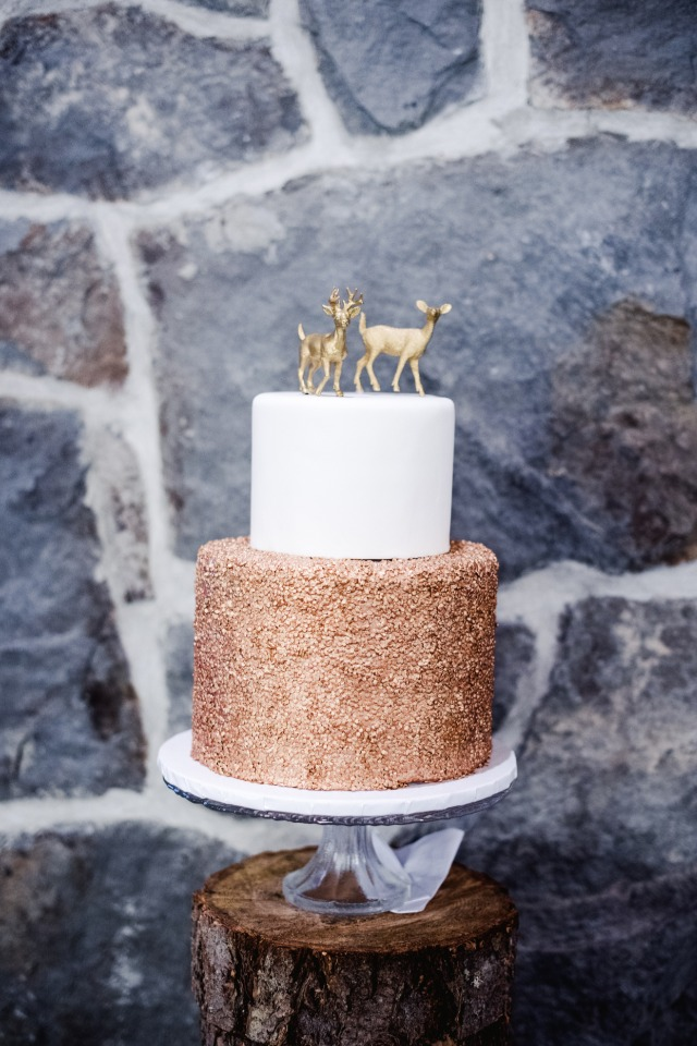 Gold and white cake with deer toppers