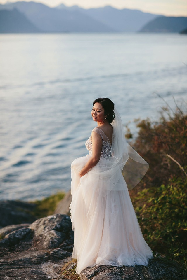 bride looking out over the water in Vancouver
