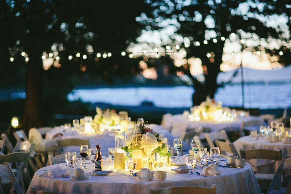 night time wedding reception with glowing centerpiece