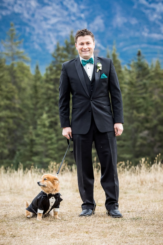 A groom and his dog