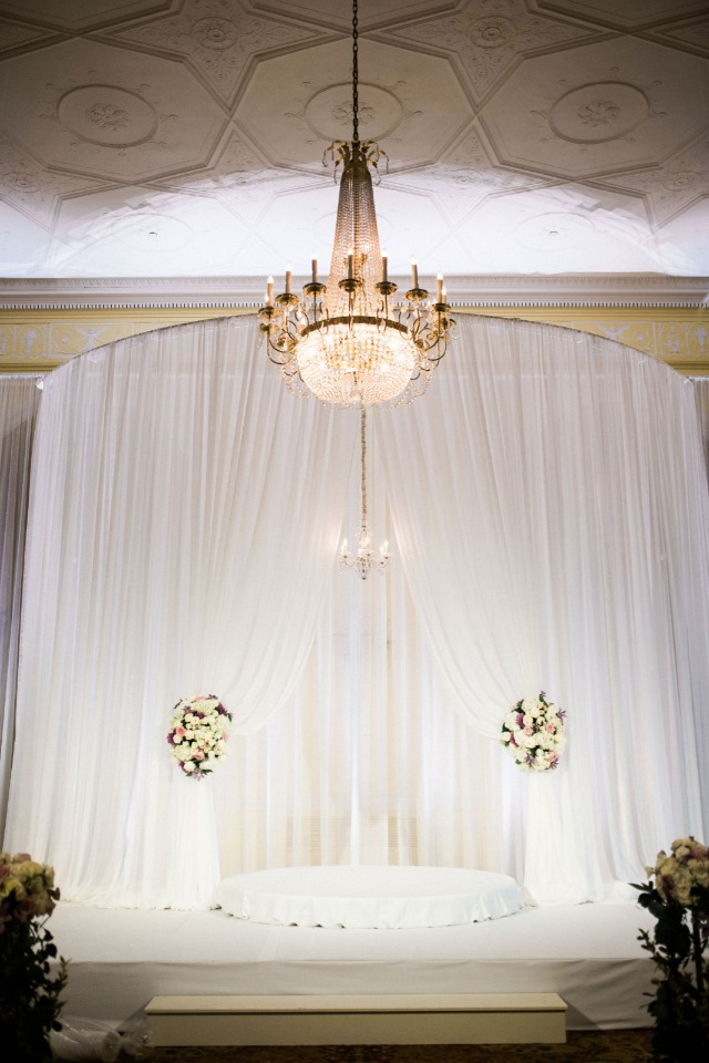 glammed up white wedding ceremony stage