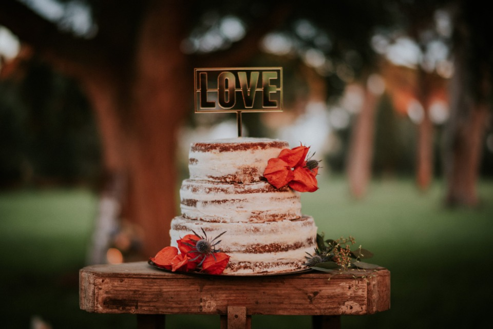 Naked cake with love topper