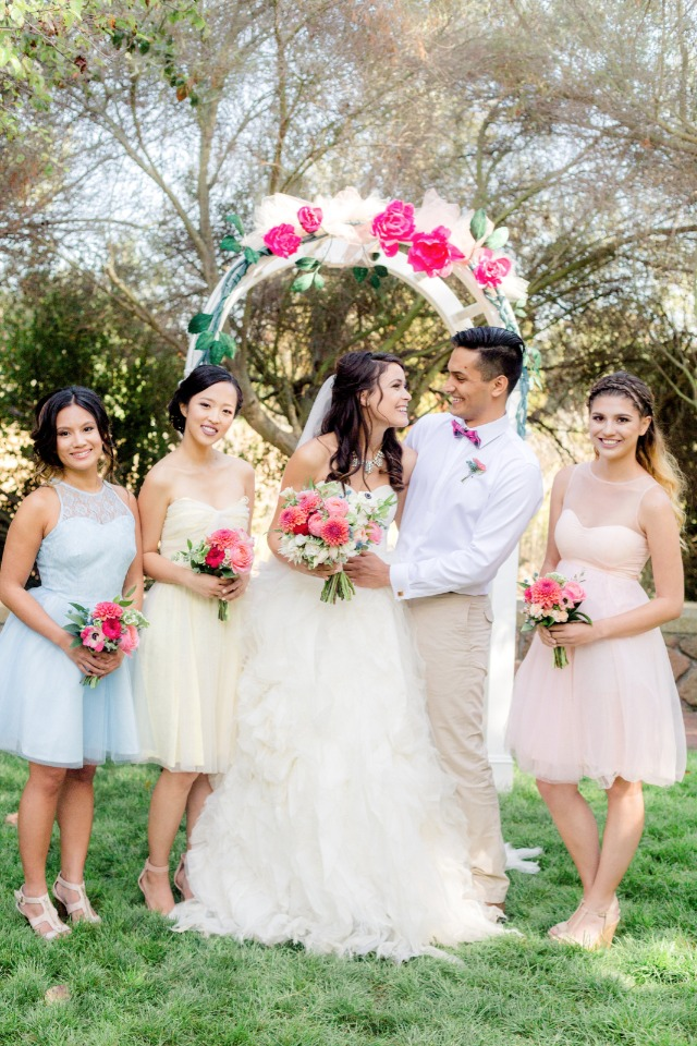 mix and match bridesmaid dresses in blue, yellow and pink