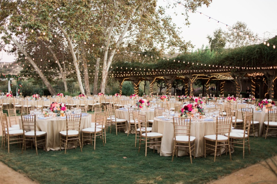 Gorgeous chic outdoor reception with bistro lights