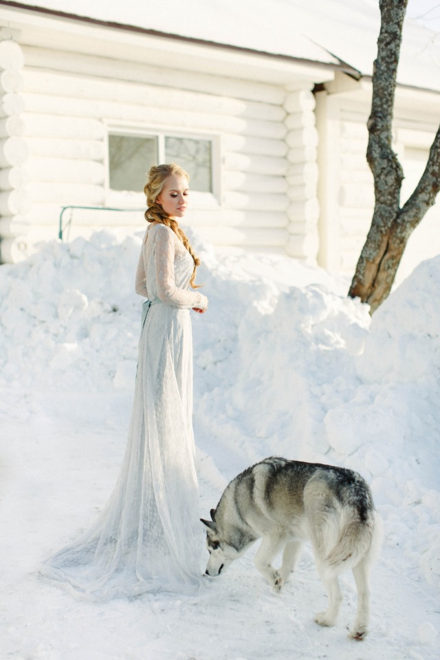 bride in blue on her winter wedding day