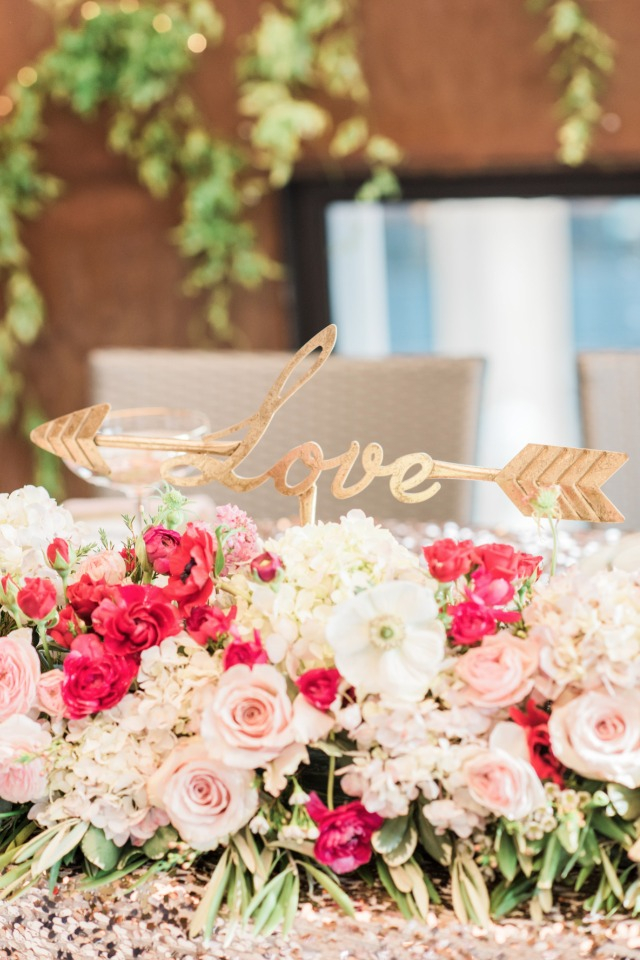 Sweetheart table florals and cute love sign