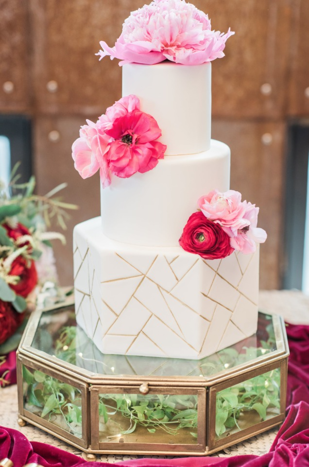 White and gold geometric wedding cake with pink peonies