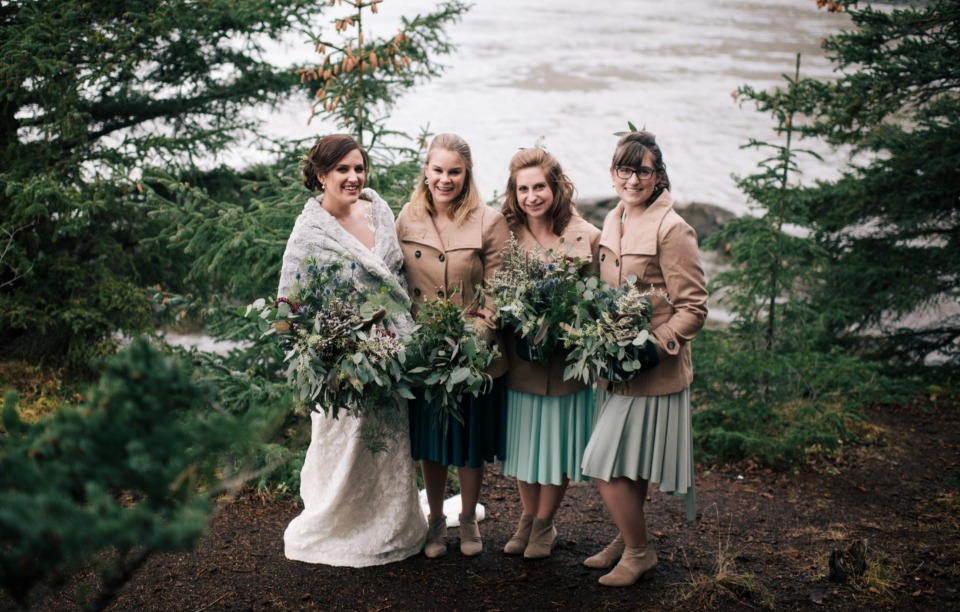bride and bridesmaids staying cozy