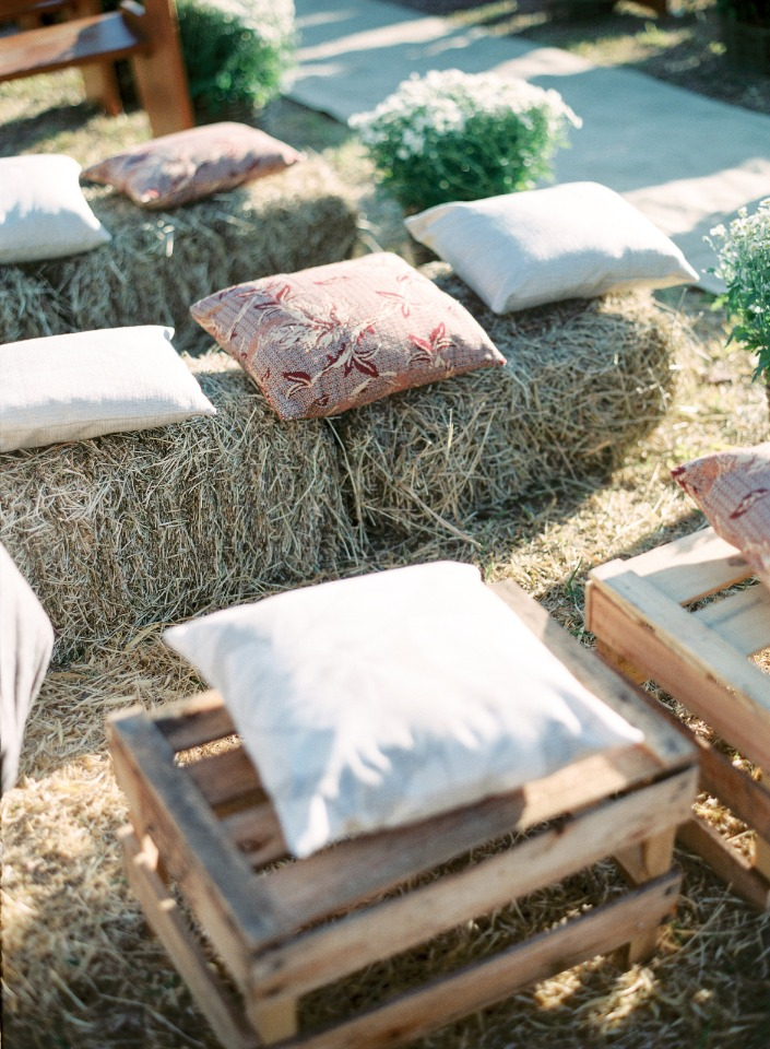 hay bale and pillow guest seating