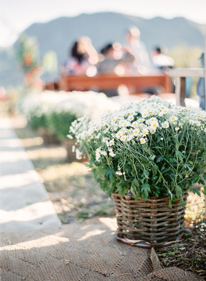 baskets of flowers for your wedding aisle