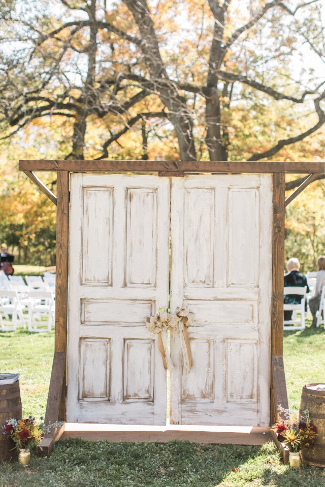 Rustic ceremony entrance with old doors