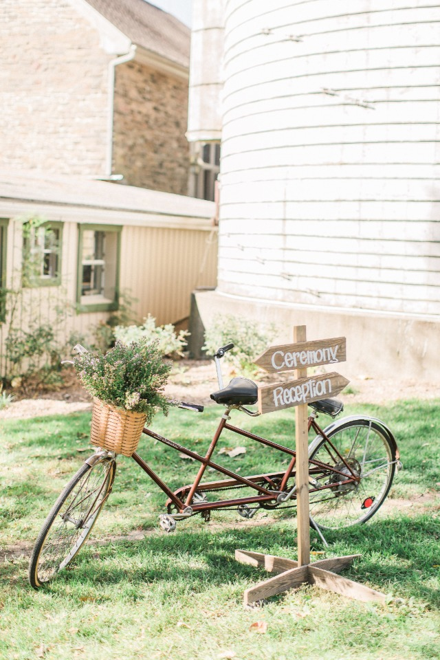 Ceremony and reception signage with vintage tandem bike decor