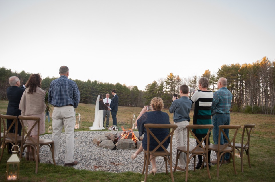 "saying ""I do"" next to the campfire"