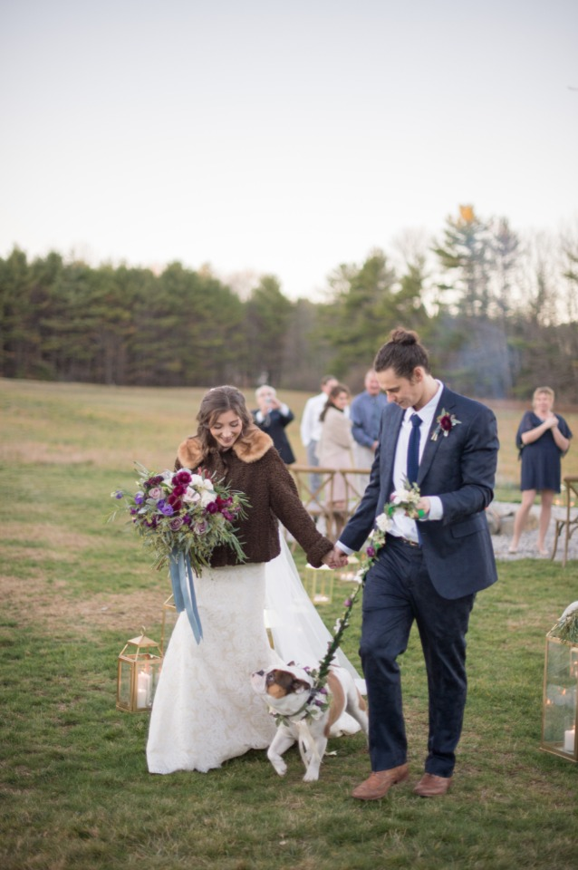 newlyweds and wedding dog