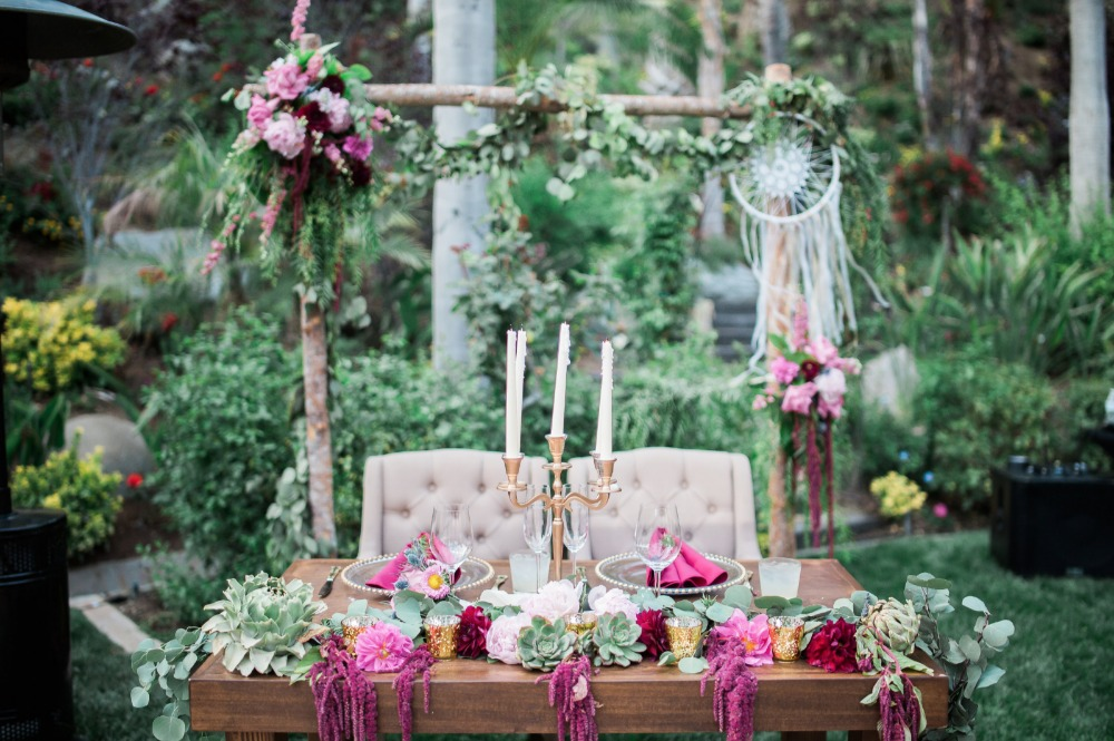 Reuse your ceremony arbor as a backdrop for your sweetheart table